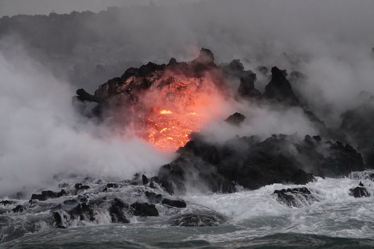 Red-hot lava enters the ocean on the big island of hawaii during a recent volcanic eruption