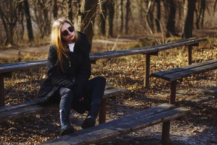 Beautiful Woman Sitting On Bench In Park