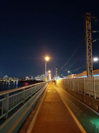 a walking roal on the bridge EyeEm Gallery City Cityscape Illuminated Bridge - Man Made Structure Light Trail Road Long Exposure City Life Street Light Sky