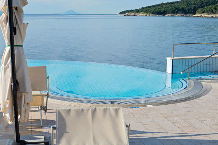 Empty infinity pool on the sunrise, quiet bue sea Absence Architecture Beauty In Nature Blue Built Structure Day Horizon Over Water Luxury Luxury Hotel Nature No People Outdoors Scenics Sea Sky Swimming Pool Tranquility Water
