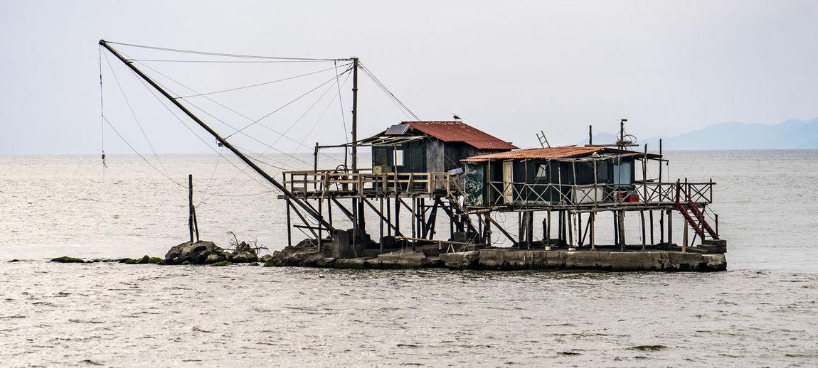 Lifeguard hut in sea against sky