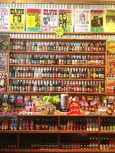 Soda Pop Shop Variation Large Group Of Objects Collection Choice Food And Drink Arrangement Abundance Indoors  Food For Sale Still Life Multi Colored Order Freshness Retail  Candy Rack In A Row Group Of Objects Shelf Soda Choices Pop Shop Flavor Vintage