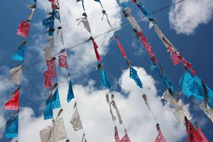 Bunting Celebration Celebration Event Cloud - Sky Cultures Day Flag Hanging Holiday Low Angle View Mexico Multi Colored No People Outdoors Sky Spirituality Streamer Tradition Traditional Festival This Is Latin America