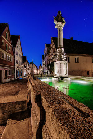 Going green. No People Germany Night Photoraphy Travel Destinations Cityscape Night Lights Illuminated Long Exposure Architecture Europe Rothenburg Ob Der Tauber Bavaria Architecture Architecture_collection Town TOWNSCAPE Blue Hour Outdoors Water_collection Multi Colored Night Photography Building Exterior Water Fountain Water Flowing Green Water