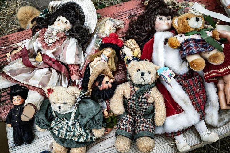 High angle view of old stuffed toys