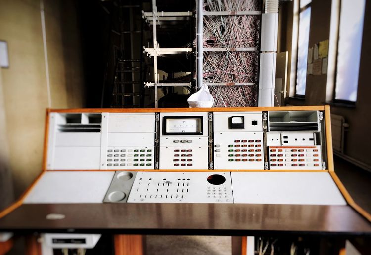 Abandoned telecom provider relay station with wire mesh Outdated Tech Vintage Wire Mesh Console Telecom Telecommunications Equipment Abandoned EyeEm Selects No People Indoors  Technology Control Machinery Equipment Communication Industry
