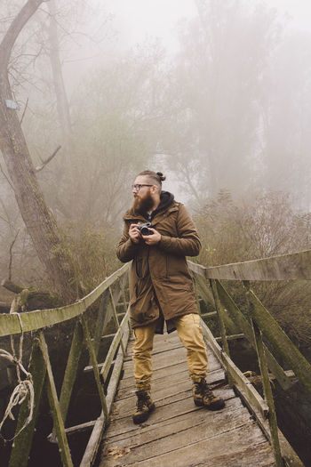 photographer in a foggy forest Adventure Club Calm Calmness EyeEm Best Shots EyeEm Nature Lover Hiking Macva Modern Relaxing Retro Serbia Tree Trekking Adventure Bearded Forest Photography Model Nature_collection One Man Only Outdoors Photographer Portreait Serbian_beauties Fashion Stories Modern Workplace Culture