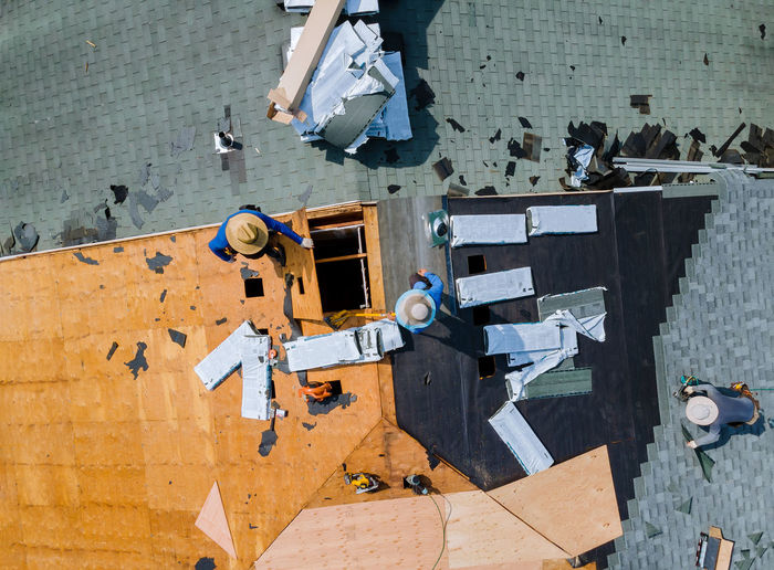 Directly above shot of people working on roof top