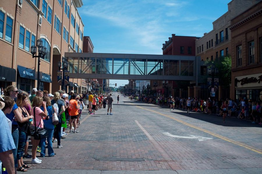 June 18, 2016 / Grandma's Marathon Architecture Building Built Structure Casual Clothing City City Life City Street Crowd Day Diminishing Perspective Duluth Grandma's Marathon Group Of People Large Group Of People Leisure Activity Lifestyles Mixed Age Range Outdoors Person Road Sky Store The Way Forward Vanishing Point