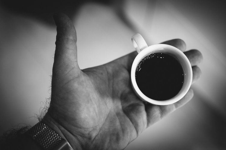 Cropped Hand Of Man Holding Coffee Cup