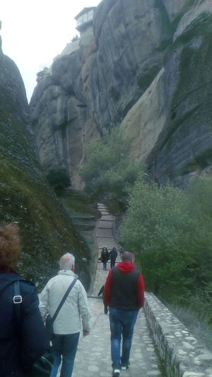 Men Women Water Mountain Rear View Warm Clothing Walking Togetherness Architecture Sky Steps And Staircases Rocky Mountains Rainy Season Stairs Staircase Steps