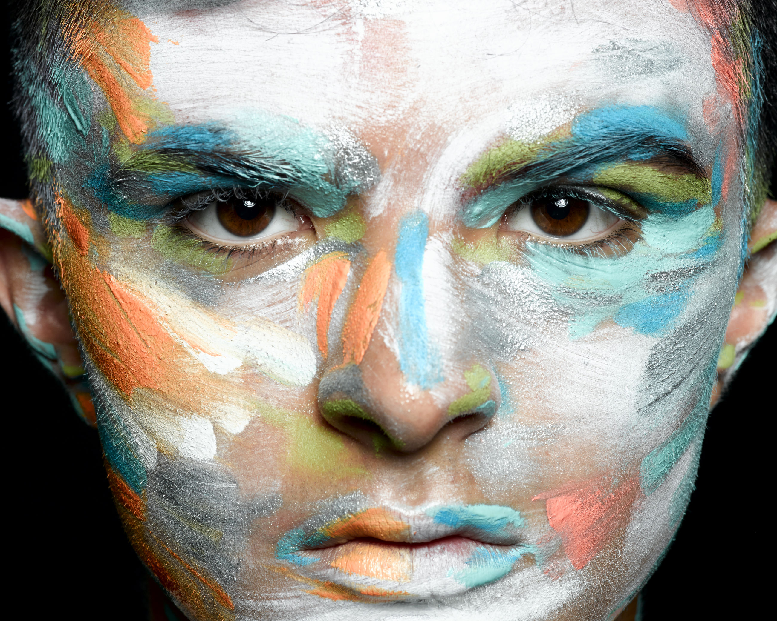 portrait, close-up, paint, human face, multi colored, one person, face paint, body part, human body part, art and craft, looking at camera, men, headshot, creativity, studio shot, front view, serious, males, adult, black background