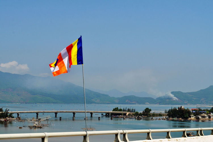 Colourful flag on bridge at Lang Co, Vietnam. Beauty In Nature Blue Bridges Cloud Colour Day Flag Haze Lăng Cô Mountain Nature No People Outdoors Scenics Sea Sky Smoke Tranquil Scene Tranquility Vietnam Water