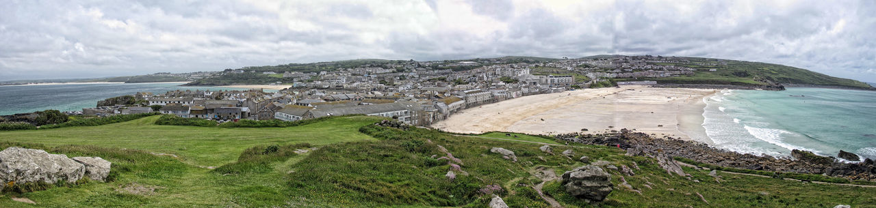 Panoramic view of st ives against cloudy sky