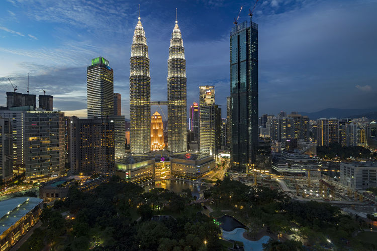 Cityscape of Kuala Lumpur, Malaysia at dusk Nightphotography Suria KLCC Architecture Blue Sky Building Exterior Built Structure City Cityscape Cloud - Sky Day Development Garden High Rise Building Illuminated Modern Outdoors Petronas Twin Towers Sky Skyscraper Travel Destinations Twin Towers