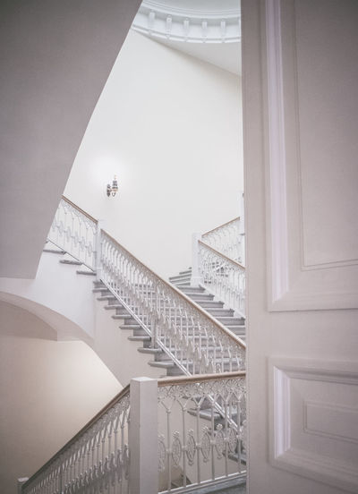 All stairs is yours. Nobody is waiting up and down. Architecture Staircase Built Structure Railing Low Angle View Design Simplicity Indoors  Steps And Staircases Home Interior Wall - Building Feature Door Lighting Equipment White Color Entrance Ceiling Absence
