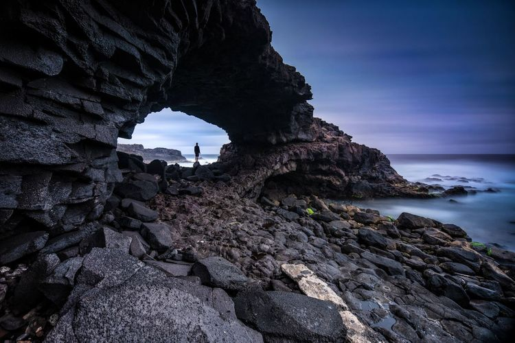 The Hole EyeEm Best Shots EyeEmNewHere EyeEm Nature Lover Eye4photography  EyeEm Gallery Sky Travel Destinations Tranquility Landscape Nature Man Adventure Beauty In Nature Real People Astronomy Sea Cliff Cave Natural Arch Rock - Object Lava Beach Eroded Dramatic Sky Dramatic Landscape Sky Only Hiker Physical Geography The Traveler - 2018 EyeEm Awards The Great Outdoors - 2018 EyeEm Awards A New Beginning A New Perspective On Life Capture Tomorrow