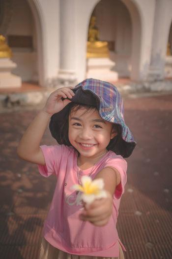 Portrait of a smiling girl holding umbrella