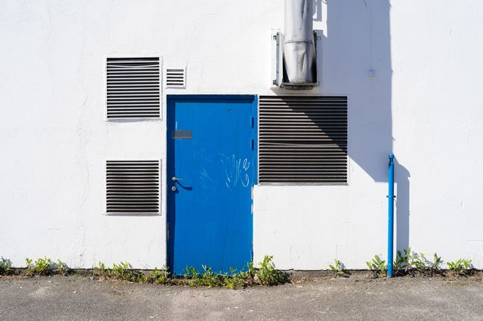 White wall Abandoned Buildings Architecture Blue Door Daylight Door Doorknob Grafitti Horizontal Symmetry Industrial June 2017 Norway Norway🇳🇴 Pipes Shaddow Shapes And Patterns  Sony A7 Square Shapes Streetphotography Ventilation Grille Vintage Lens Weed White Wall