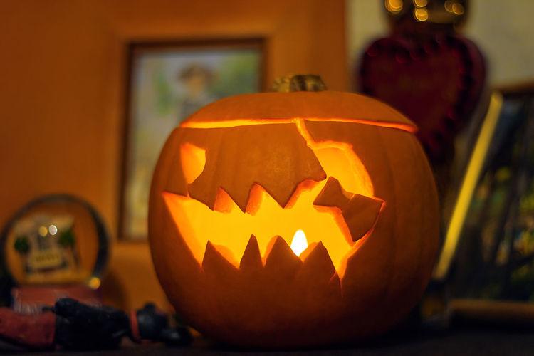 View of illuminated pumpkin on table during halloween