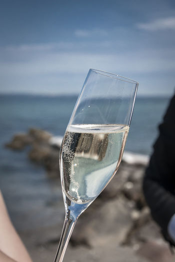 Close-Up Of Champagne Flute At Beach