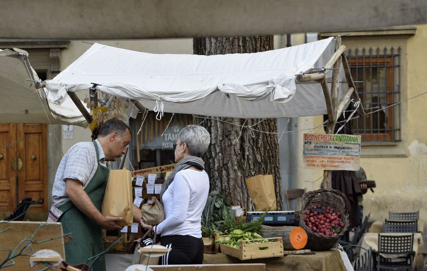 Market Stall Fresh Produce Canopy Two People Small Business People Working Adult Lifestyles Real People Visit Italy Street Photography The Week On EyeEm Italy Florence Tree Trunk. Farmers Market Mature Adult Piazza Santo Spirito Selling Adults Only Business