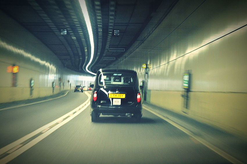 'Follow That Cab' Black Cab London Cab Taxi London Taxi Capturing Movement In Motion Moving Traffic Traffic Yellow Lines Tunnel In The Tunnel Lights Car LONDON❤ My City London London Life London Transport London Traffic United Kingdom Nikon D3200