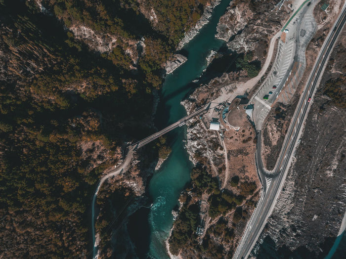 Aerial View Architecture Beauty In Nature Built Structure Connection Day High Angle View Highway Mountain Mountain Road Nature No People Outdoors Road Scenics - Nature Transportation Travel Travel Destinations Water