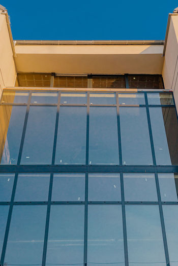 Low angle view of swimming pool against building