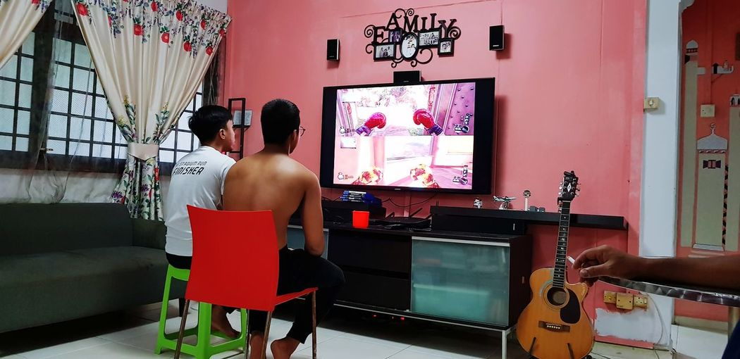 Brothers playing PlayStation Playing Playstation Togetherness Brothers For Life Having Fun Shirtless Individuality EyeEmNewHere