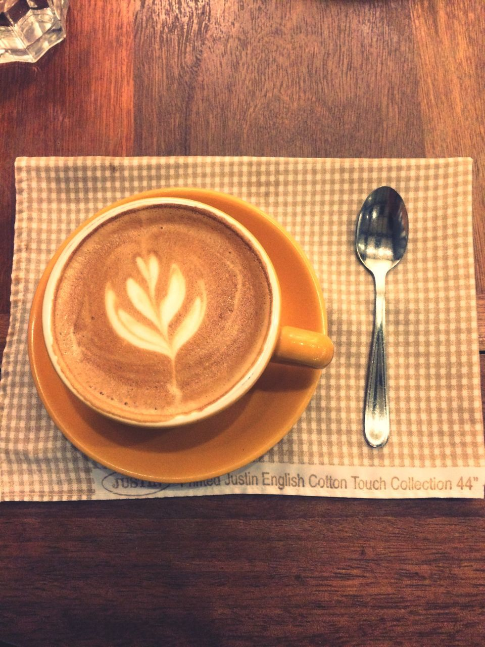 table, coffee cup, coffee - drink, food and drink, refreshment, indoors, drink, no people, high angle view, frothy drink, wood - material, froth art, directly above, cappuccino, plate, close-up, freshness, day
