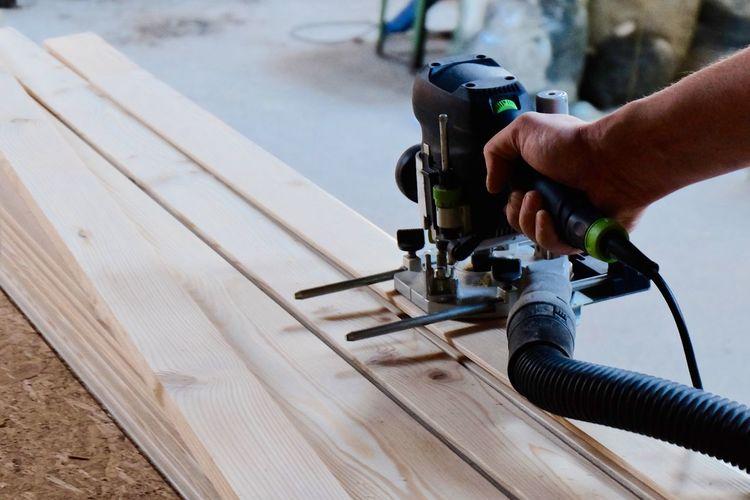 Carpenter Cutting Wood With Machine