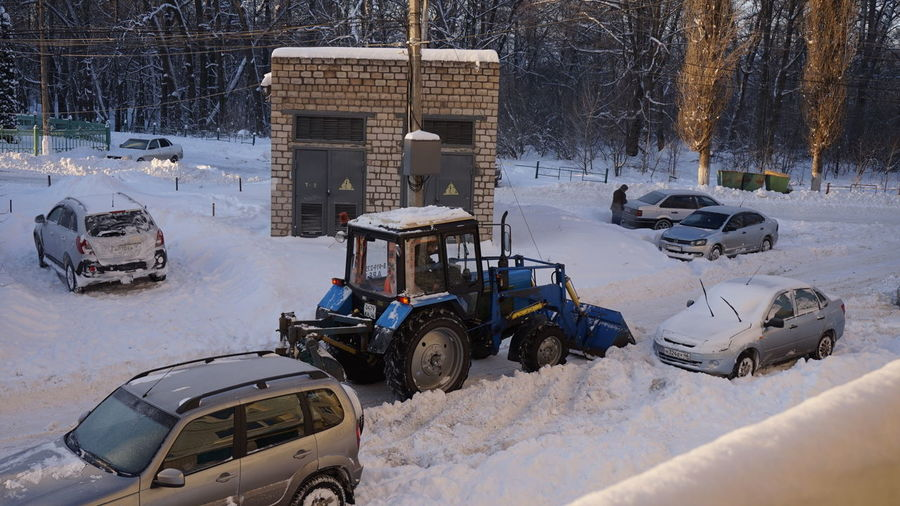High Angle View Of Vehicles On Snow Covered Field During Winter