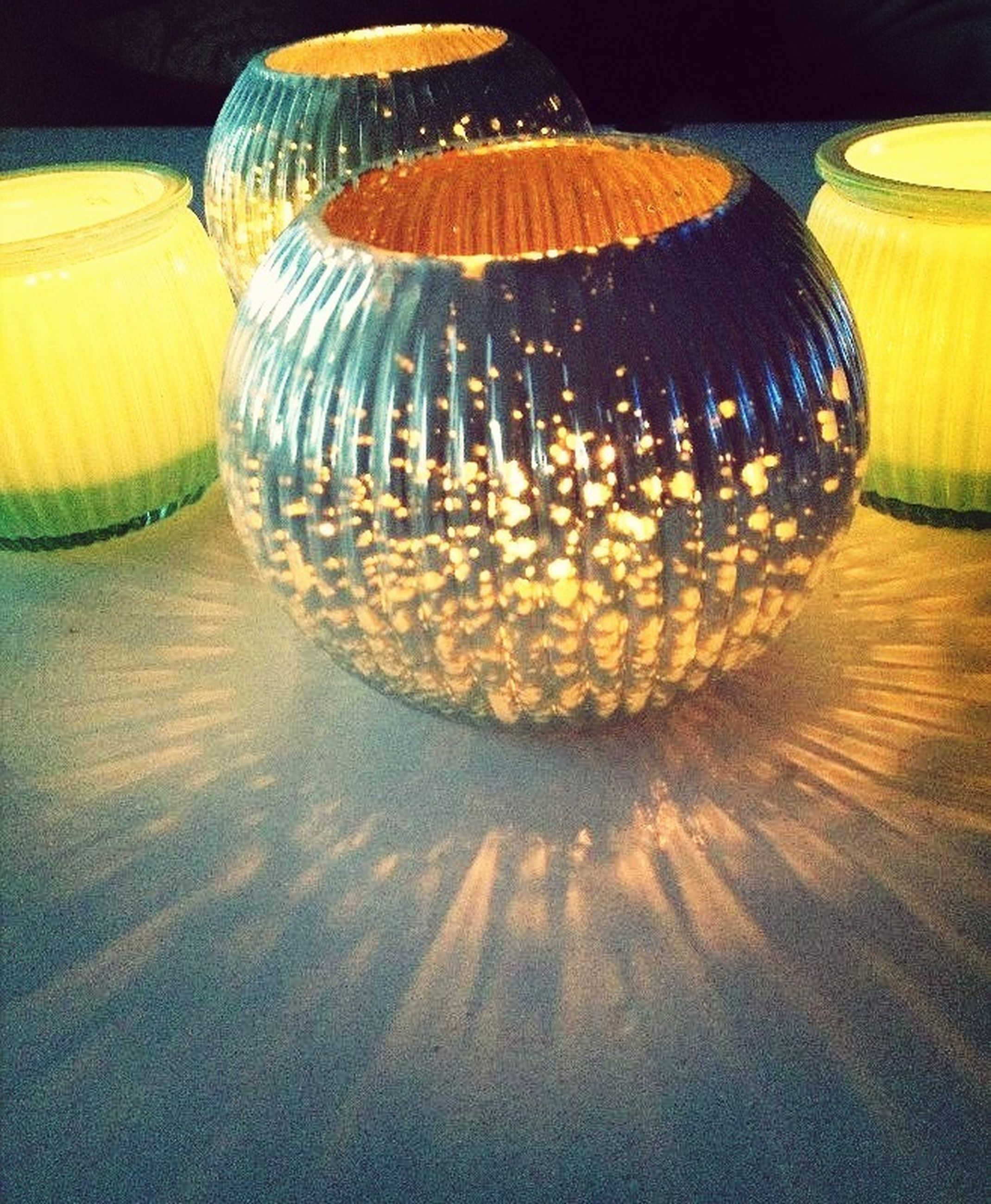 indoors, illuminated, decoration, still life, celebration, close-up, tradition, multi colored, pattern, night, cultures, no people, sphere, design, table, art and craft, lighting equipment, lantern, yellow, glowing