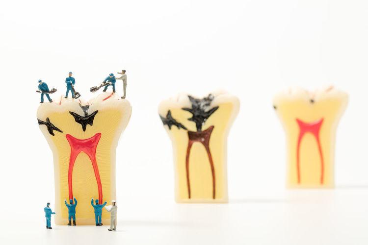 Caries Dentist Doctor  Gum Healthcare And Medicine Hospital Hygiene Miniature Team Work Teeth Model White Background