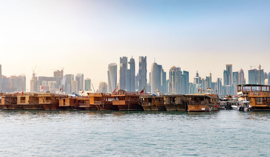 Dhow harbor in Doha, Qatar Architecture Building Exterior Built Structure City Cityscape Clear Sky Day Dhow Doha Downtown District Harbor Modern Moored Nautical Vessel Outdoors Qatar Sea Ship Sky Skyscraper Sun Traditional Urban Skyline Water Waterfront Fresh On Market 2017