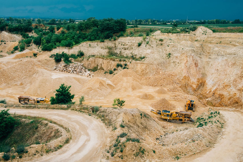 Minerals Architecture Construction Industry Construction Machinery Environment Geology High Angle View Industrial Equipment Industry Land Landscape Machinery Mine Mining Mode Of Transportation Nature No People Outdoors Quarry Road Stone Surface Mine Transportation Truck Vehicle