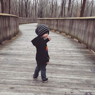 Full Length Child One Person Childhood Children Only People Walking Males  Warm Clothing One Boy Only Boys Standing Outdoors Day Headwear Adult