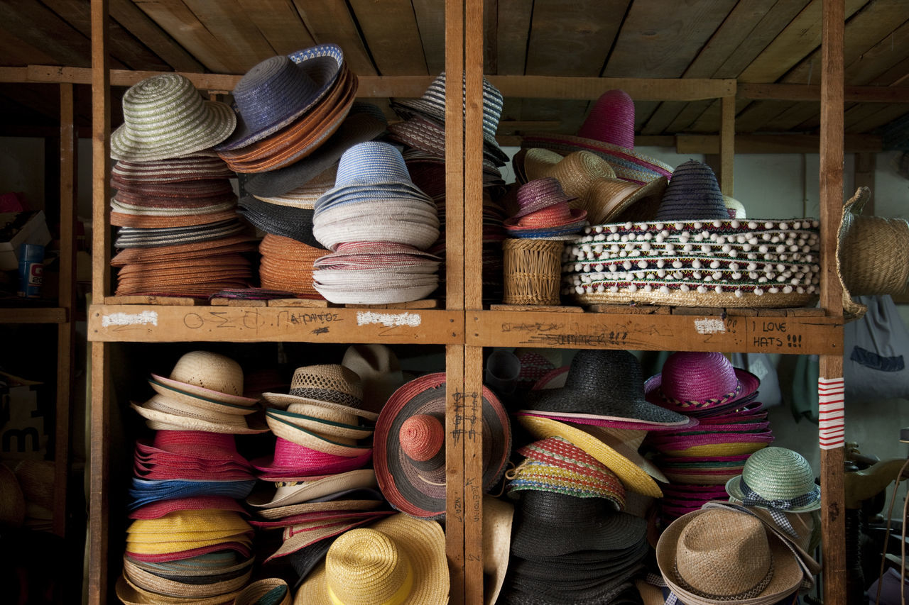 Various Sun Hats On Shelves At Store