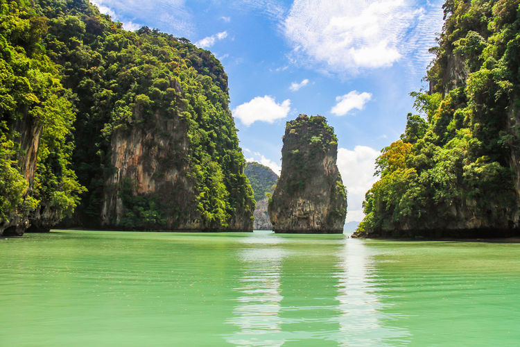 The James Bond Island in Phuket Thailand James Bond James Bond Island Panga Bay Pangga Bay Krabi Phuket Phuket Thailand Water Beauty In Nature Scenics - Nature Tranquility Tranquil Scene Tree Plant Sky Waterfront Sea Nature Day Idyllic Land Cloud - Sky No People Rock Outdoors Green Color Turquoise Colored Bay