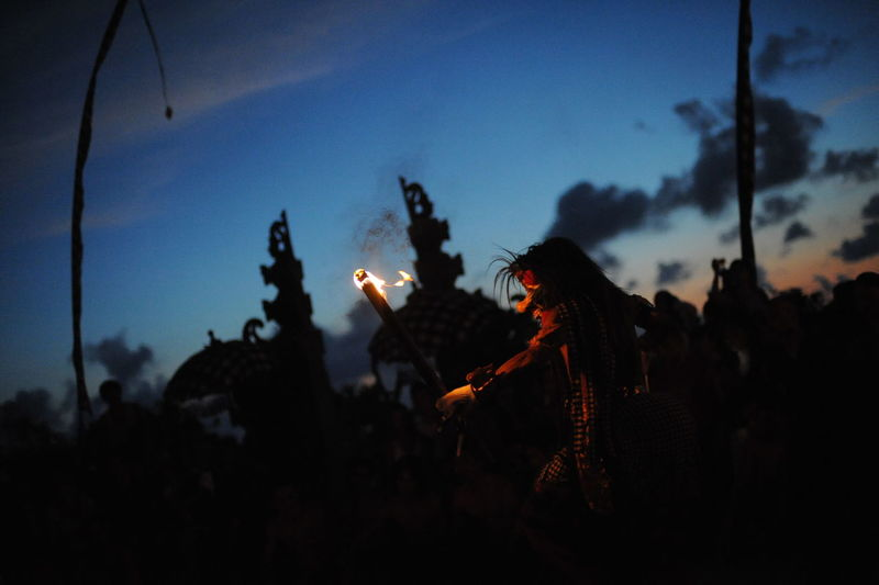 Person performing kecak dancing at dusk