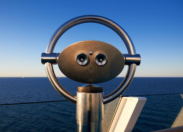 Beauty In Nature Binoculars Blue Clear Sky Close-up Coin Operated Coin-operated Binoculars Day Focus On Foreground Hand-held Telescope Horizon Horizon Over Water Metal Nature No People Outdoors Scenics - Nature Sea Security Silver Colored Sky Water