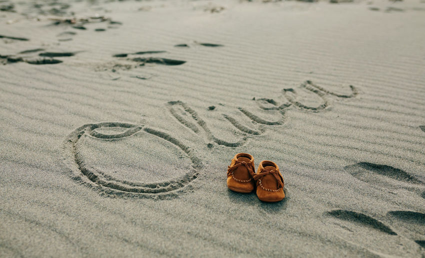 Baby booties by text at sandy beach