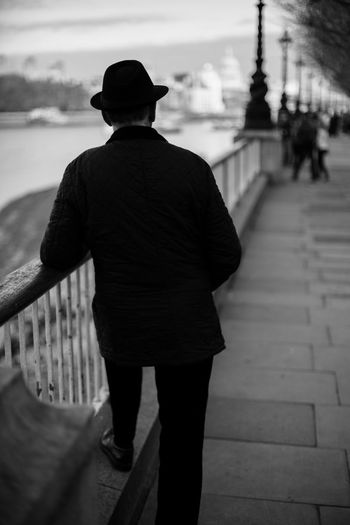 Adult Adults Only Day Interesting Interesting Hat Men One Man Only One Person Only Men Outdoors People Railing Real People Rear View Sky Standing