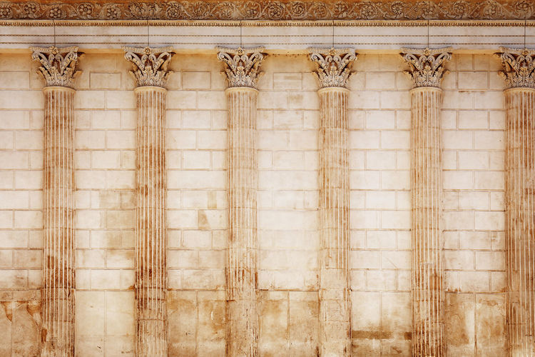 "Side view of Maison Carrée (French for ""square house""), an ancient building in Nîmes, one of the best preserved Roman temple facades to be found in the territory of the former Roman Empire Wall - Building Feature Architecture No People Built Structure The Past Backgrounds Pattern History Textured  Building White Color Old Day Antique Architectural Column Classical Style Roman Temple Ancient Rome Greek Famous Place Tarvel Destination Tourism Provence Landmark"