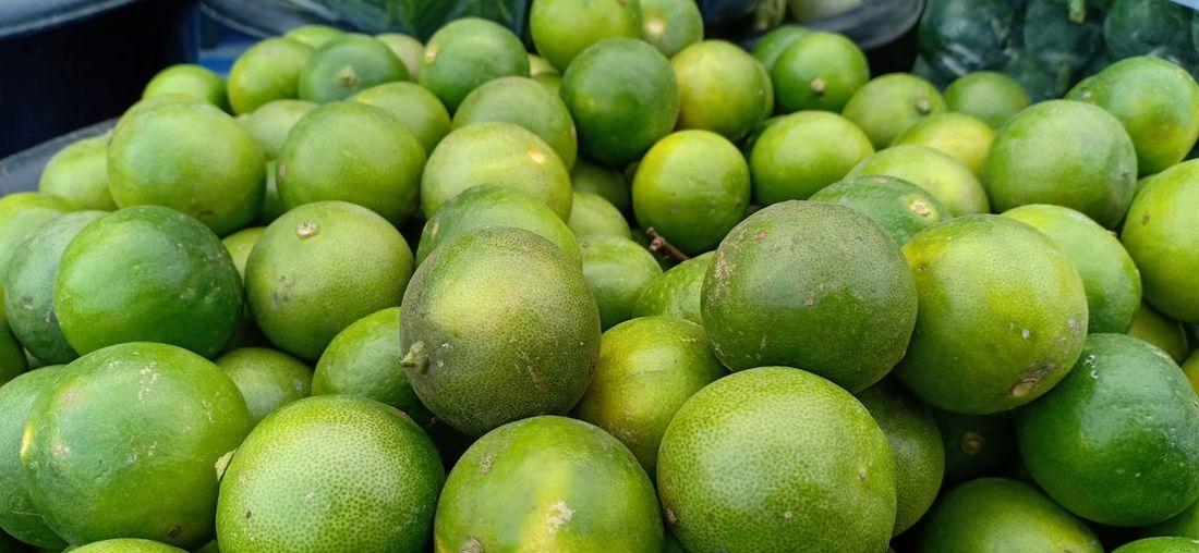 Full frame shot of lemons in market for sale