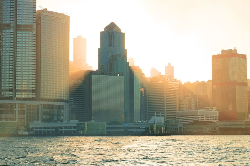 Orenge Sky Sunset_collection Sunset Silhouettes Sea Sea View Reflection HongKong Hongkong Photos Hong Kong Architecture Skyscraper Architecture Cityscape City Modern Urban Skyline Business Finance And Industry Sunset Building Exterior Tower Development No People Built Structure Downtown District Sunlight Outdoors Day Travel Destinations Sky EyeEmNewHere An Eye For Travel