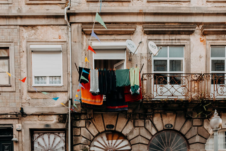 Low angle view of clothes drying on old building