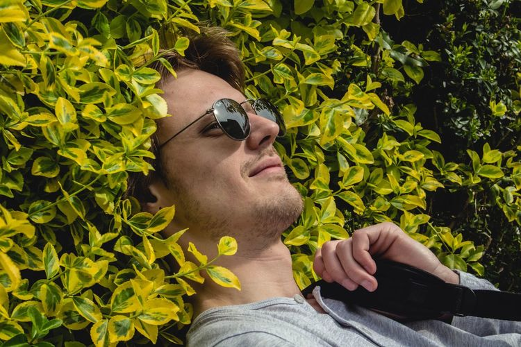 April Day Enjoying Life Enjoying The Sun Friends Green Color Growth Headshot Leaf Lifestyles Men Person Plant Portrait Relax Relaxing Showcase April Smile Spring Sunglasses Sunny Day The Week Of Eyeem The Week On Eyem Tree Young Adult