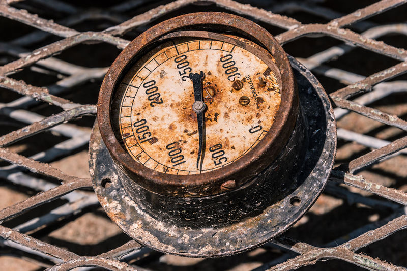 Close-Up Of Rusty Gauge On Fence